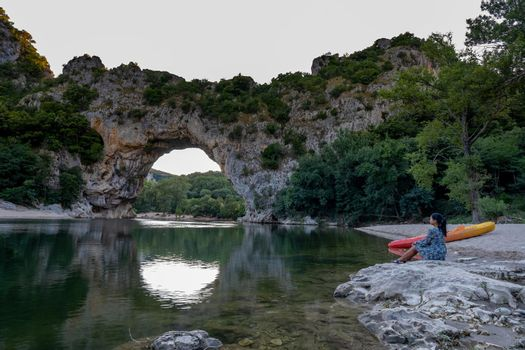 woman on the beach by the river in the Ardeche France Pont d Arc, Ardeche France,view of Narural arch in Vallon Pont D'arc in Ardeche canyon in France Europe