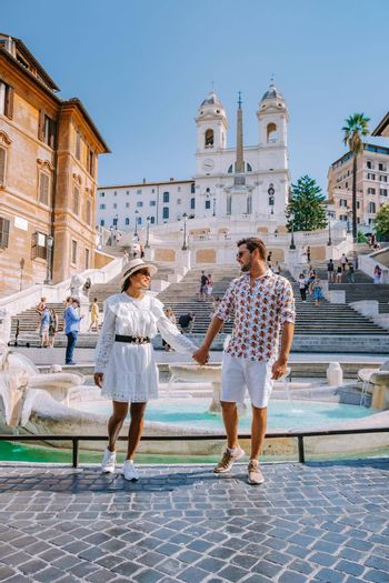 The Spanish Steps in Rome, Italy. The famous place is a great example of Roman Baroque Style. Italy couple on city trip in Rome