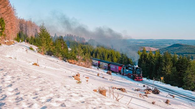 Harz national park Germany, Steam train on the way to Brocken through the winter landscape, Famous steam train through the winter mountain. Brocken, Harz National Park Mountains in Germany Europe