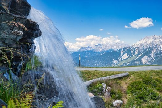 Mountain landscape in Summer with waterfall