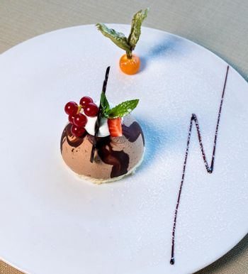 Beautiful rounded chocolate dessert close up