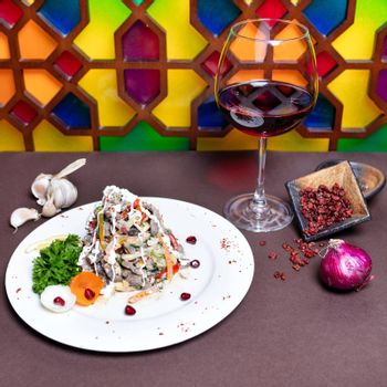 Tasty salad with red wine with colorful background