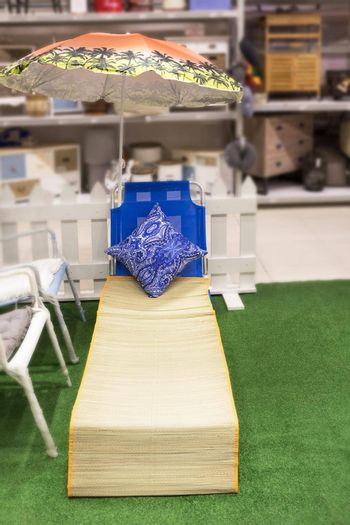 Outdoor summer chair at the store isolated
