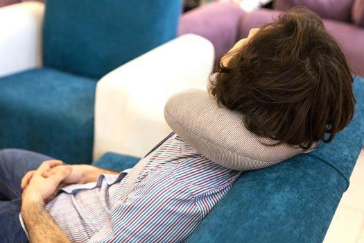 Man sleeping with a nap pillow