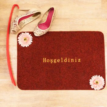 Red welcome doormat top view, welcome word in the Turkish