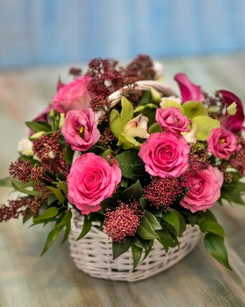 Colorful pink flower bouquet in the basket