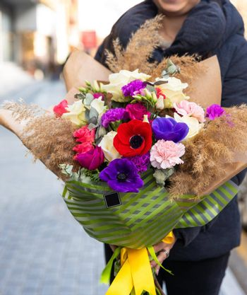 Woman holding beautiful flower bouquet