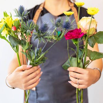 Florist woman holding different flowers