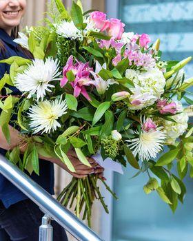 Woman holding beautiful bouquet flower