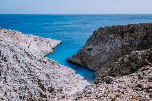 Crete Greece Seitan Limania beach with huge cliff by the blue ocean of the Island of Crete in Greece, Seitan limania beach on Crete, Greece. Europe