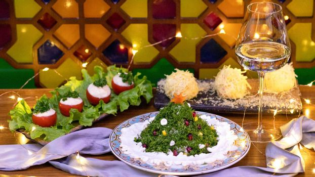 Salad like a new year tree with cheese balls