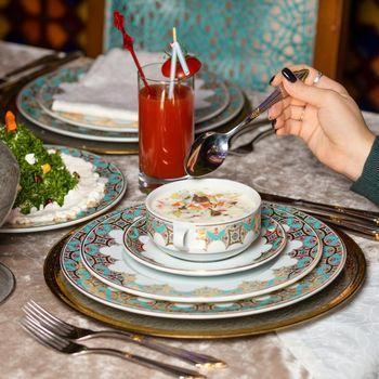 Woman eating yogurt based meal at the restaurant