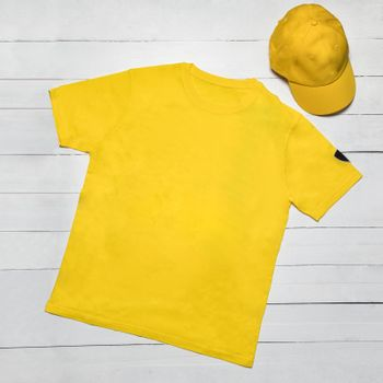 Yellow man sport t-shirt with a cap isolated
