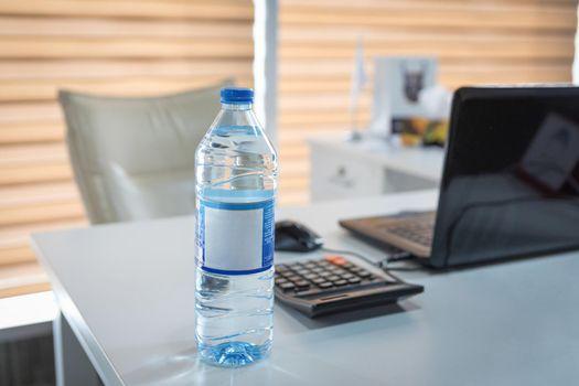 Plastic water bottle on the office desk