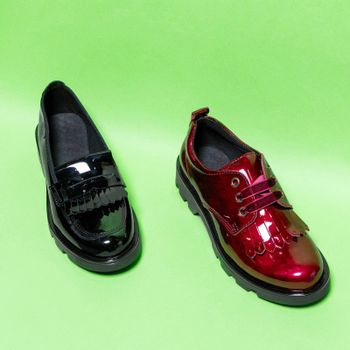 Red and black shiny male shoes isolated