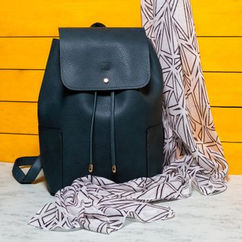 Black woman backpack with a scarf isolated