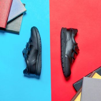 Black sport shoes for man isolated top view