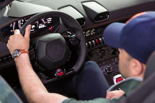 Man driving a cabriolet sports car close up