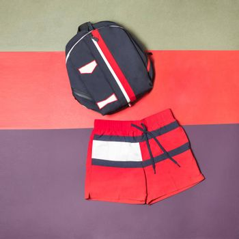 Red man short and backpack isolated top view