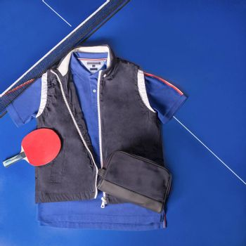 Blue tennis wear, shirt and jacket top view