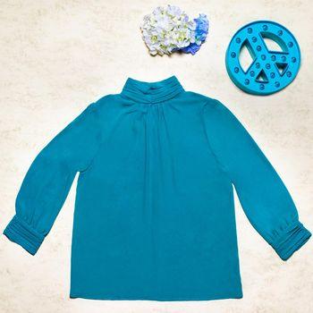 Stylish blue female sweater on white background
