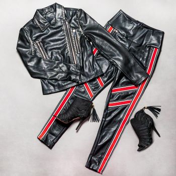 Black and red leather woman jacket pant and shoe isolated