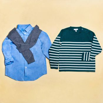 Casual man wear shirt and sweater isolated top view