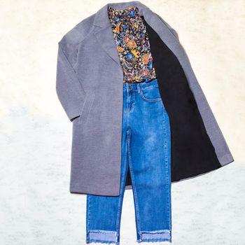 Color woman autumn coat shirt jeans set isolated