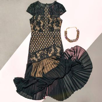 Black lace patterned bouquet dress with a necklace isolated