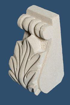 Plaster graceful decoration on the columns, dark background