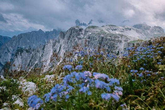 hiking in the italian dolomites during foggy weather with clouds, Stunning view to Tre Cime peaks in Dolomites, Italy. Europe