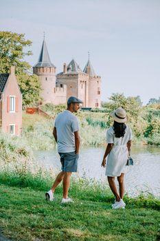 Muiderslot castle near Amsterdam - Netherlands, Muideslot during summer in the Netherlands. Europe Couple visiting Muiderslot on a trip