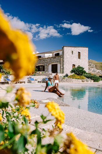 Agriturismo bed and breakfast at Sicily Italy, beautiful historical old farm renovated as BB Sicilia, a couple on vacation at Sicilian luxury agriturismo