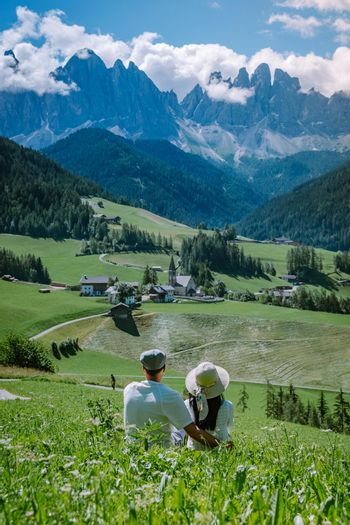 Couple on vacation Santa Magdalena Village in Dolomites area Italy, couple on vacation Val Di Funes Italian Dolomites Europe