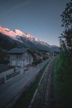 A railway running through an alpine town in France.