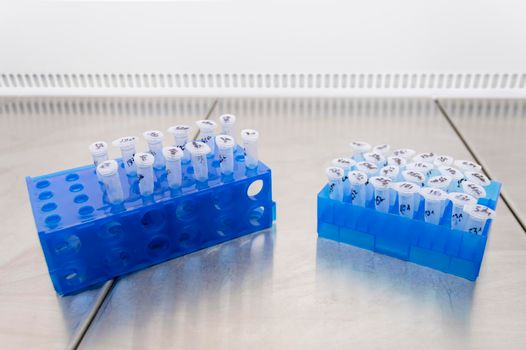 Two racks with virus samples for experiment and study in the laboratory.