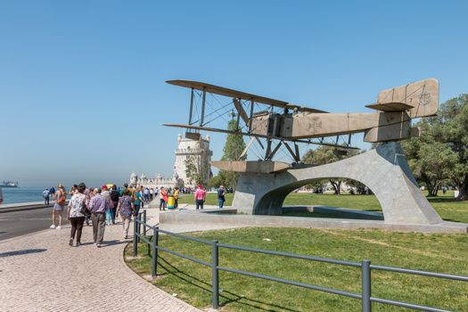 Lisbon, Portugal - May 7, 2018: Tourists walking next to Fairey III-D aircraft, Replica of the first aircraft that made the first crossing of the South Atlantic by Gago Coutinho and Sacadura Cabral