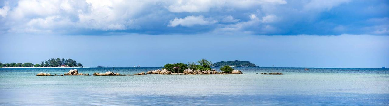 Panorama shot of bintan island with blue sky, clear ocean water and bueatiful islands