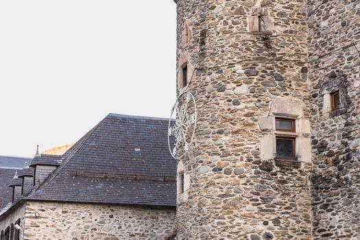 Saint Lary Soulan, France - December 26, 2020: architectural detail of the Maison Du Parc National Des Pyrenees (house of the Pyrenees National Park) in the historic city center where tourists walk on a winter evening