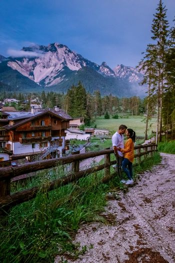 couple on vacation in the, Dolomites Italy, small church during cloudy foggy weather, San Vigilio di Marebbe,South Tirol,Italy San Vigilio di Marebbe small town in Dolomites mountain Europe