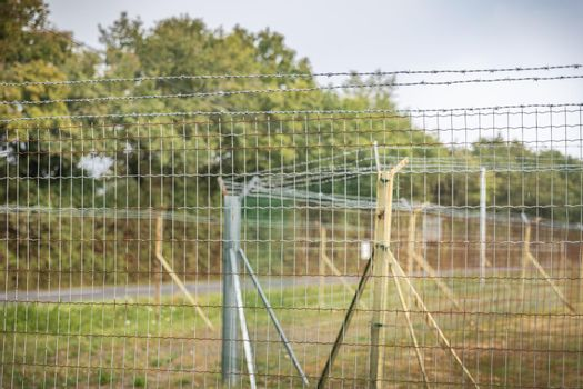 double barbed wire mesh protecting military installations or a border - concept