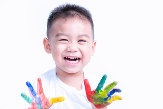 Happy asian child kid smile on education art show hand with water color or finger paint on hands