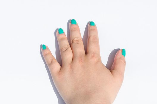Green manicure on short nails