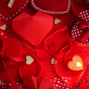 Many valentine day hearts and decor, homemade craft concept, red fabric, paper, gifts and candles