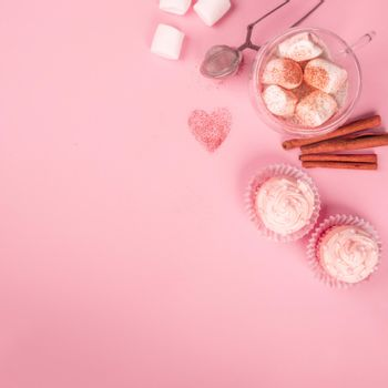 Valentine day love cupcake decorated with cream and hot chocolate on pink background with copy space for text