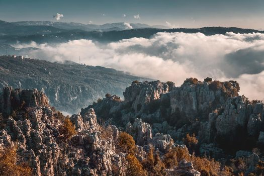 Picturesque Landscape of High Mountains Covered with White Thick Clouds. Amazing Wild Nature. Beauty of Lebanon.