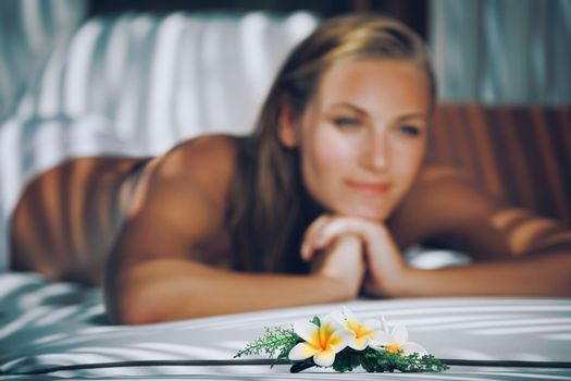 Selective Focus Photo. Beautiful Woman Lying Down on Massage Table. Enjoying Day at Spa. Body Care and Therapy Treatment. Healthy Lifestyle.