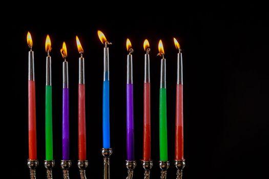 Jewish Religion holiday symbol for Hanukkah in hanukkiah Menorah with burned candles