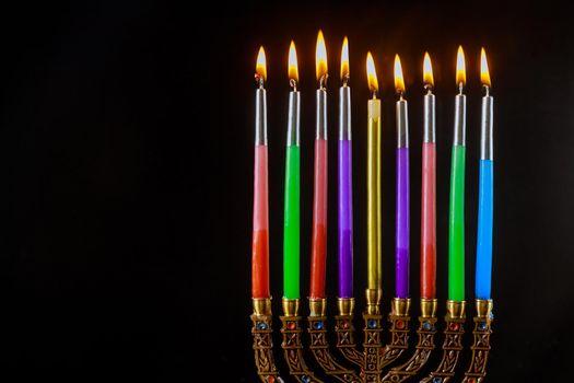 Jewish traditional holiday Hanukkah with hanukkiah menorah on nine candles