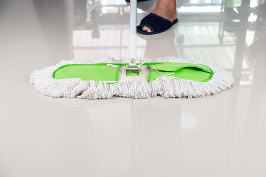 Clean the tile floor with a mop.